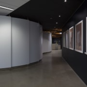 Curvaceous Alucobond panels reconcile angles and dead corners architecture, exhibition, floor, interior design, lobby, product design, black, gray
