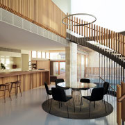 A timber-slat balustrade on this spiral staircase and architecture, interior design, lobby, real estate, stairs, white