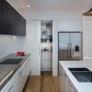 Part of a contemporary kitchen design by Pauline countertop, interior design, kitchen, real estate, gray