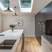 Designer Pauline Stockwell oriented this kitchen so a architecture, countertop, cuisine classique, daylighting, house, interior design, kitchen, real estate, room, gray
