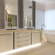In-cabinet, under counter lighting adds definition to this bathroom, bathroom accessory, bathroom cabinet, cabinetry, countertop, floor, interior design, room, sink, gray