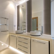 The wall mirrors are backlit in this renovated architecture, bathroom, ceiling, countertop, interior design, kitchen, product design, real estate, room, sink, gray, orange