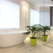 Semi-transparent blinds admit light but retain privacy in bathroom, floor, interior design, product design, tap, gray, white