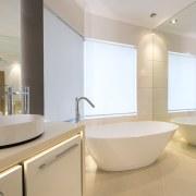 Multiple concealed lighting sources, semi-transparent blinds, and large-format architecture, bathroom, bathroom sink, home, interior design, plumbing fixture, product design, property, real estate, room, sink, tap, gray, orange