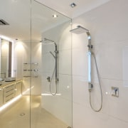 This bathrooms full-size mirror wall runs behind the bathroom, ceiling, floor, glass, interior design, plumbing fixture, room, shower, sink, tap, tile, gray