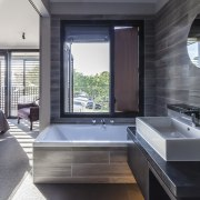 Large-format wall and floor tiles add to the architecture, bathroom, interior design, window, gray, black