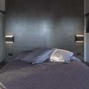 Subtle door lines are the only hint that architecture, bedroom, ceiling, interior design, real estate, room, gray, black