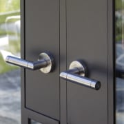 Handles for this Millbrook Resort home were custom-made door, lock, gray