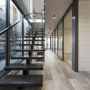 On this inner-city apartment, a light well introduced architecture, daylighting, floor, flooring, handrail, hardwood, house, interior design, laminate flooring, loft, stairs, wood, wood flooring, gray