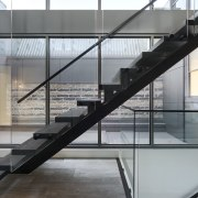 This floating stair accesses the living floor of architecture, building, daylighting, glass, handrail, product design, stairs, structure, gray