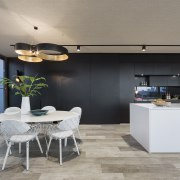 A wall of black kitchen and storage cabinetry architecture, house, interior design, kitchen, table, gray