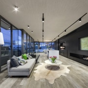 A large artwork, with tv behind, and gas architecture, ceiling, house, interior design, interior designer, living room, loft, penthouse apartment, real estate, gray, black