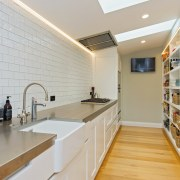 This scullery features a wall of subway tiles ceiling, countertop, floor, flooring, home, interior design, kitchen, property, real estate, room, gray