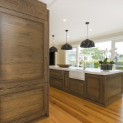 An antiqued oak cabinet with open shelves for cabinetry, hardwood, interior design, kitchen, room, wood, brown, white