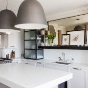Designer Chad James has evoked the colours and cabinetry, countertop, cuisine classique, interior design, kitchen, gray