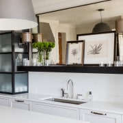 Living area design elements creep into the kitchen cabinetry, countertop, cuisine classique, home appliance, interior design, kitchen, product design, gray, white