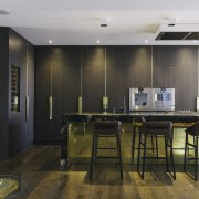 Timber veneer cabinetry and wide-plank wood floors add countertop, floor, flooring, interior design, kitchen, room, wood flooring, black