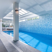 This spectacular pool and tiled mosaic wall were apartment, architecture, ceiling, daylighting, estate, interior design, leisure, leisure centre, property, real estate, swimming pool, gray, teal
