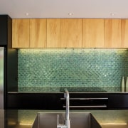 An emerald green tile splashback is a architecture, cabinetry, countertop, glass, interior design, kitchen, room, under cabinet lighting, wall