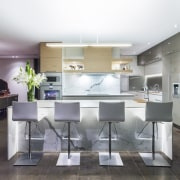 This kitchen is part of a whole house countertop, dining room, interior design, kitchen, real estate, room, gray, white