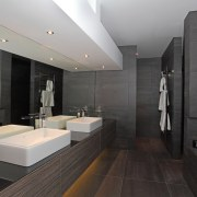 This master bathroom has a modem hotel-like aesthetic, architecture, bathroom, floor, interior design, product design, room, tile, black, gray