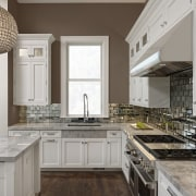 Antiqued mirror tiles back this cooking zone and cabinetry, countertop, cuisine classique, home, interior design, kitchen, gray