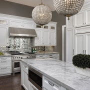 The upper cabinets in this kitchen are built cabinetry, countertop, cuisine classique, flooring, interior design, kitchen, room, gray
