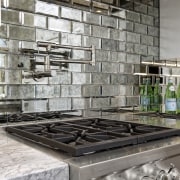 Hefty appliances meet chunky countertops in this upmarket countertop, interior design, tile, wall, gray, black