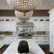 All that glisters  brass Moroccan-look chandeliers, antiqued cabinetry, ceiling, countertop, cuisine classique, home, interior design, kitchen, room, gray, white