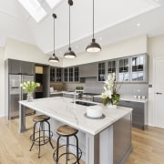 The walls in the living spaces of this countertop, cuisine classique, floor, interior design, kitchen, real estate, room, white
