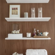 Warm walnut panelling was used as a backdrop furniture, product design, shelf, shelving, brown