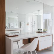 An expansive floor-to-ceiling mirror behind this makeup table cabinetry, countertop, furniture, interior design, kitchen, product design, room, table, white, gray