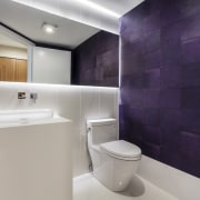This modern powder room by designers Laila Colvin architecture, bathroom, floor, interior design, plumbing fixture, product design, property, purple, room, sink, tap, tile, gray, purple