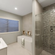This Hamilton showhome has an upmarket master ensuite bathroom, floor, home, interior design, real estate, room, gray