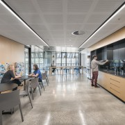 The facilitys cafeteria looks down onto the core architecture, ceiling, daylighting, institution, interior design, lobby, office, gray