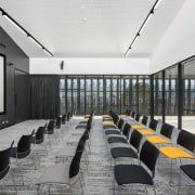 The drill core librarys high-tech 3D theatre is architecture, auditorium, conference hall, interior design, white, black, gray