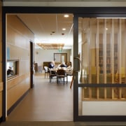 :The mental health services wards are integrated with door, interior design, lobby, brown, gray