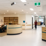 One of the many casual meeting spaces dotted floor, furniture, institution, interior design, office, product design, gray