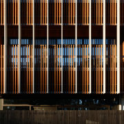 Timber slats seen from outside the atrium add architecture, line, black