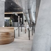 One of the ground floor lobbies of the architecture, concrete, floor, flooring, interior design, product design, table, gray