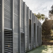 The vertical timber elements on this facade frame architecture, building, facade, grass, home, house, real estate, residential area, siding, structure, gray, black