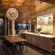 Bamboo cabinetry connects with the wider use of ceiling, countertop, dining room, interior design, kitchen, table, brown