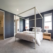 An open, airy connection between master bedroom and architecture, bed frame, bedroom, ceiling, floor, flooring, furniture, home, interior design, real estate, wall, window, wood, gray, white