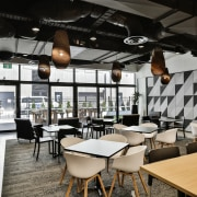 The staff cafe at the new Kathmandu headquarters café, interior design, restaurant, table, black, gray