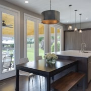 Floor-to-ceiling glazing sets this kitchen by designer Lauren countertop, dining room, interior design, kitchen, real estate, room, window, gray