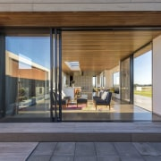 The longest wing in this home comprises the architecture, door, house, interior design, real estate, window, gray, black