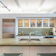 Doubling as workspace and bar, this kitchen island architecture, ceiling, countertop, daylighting, house, interior design, kitchen, real estate, window, gray, white