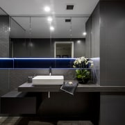 A built-out half wall concealing services and creating architecture, bathroom, glass, interior design, room, black