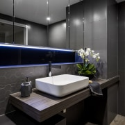 Wood veneer meets wood-look floor tiles in this architecture, bathroom, interior design, room, sink, black, gray