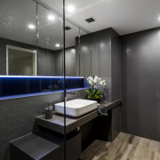 Original surfaces are in smooth tile, while a architecture, bathroom, interior design, public toilet, room, black, gray